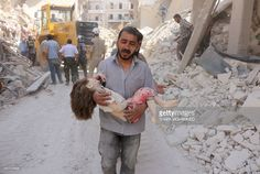 Graphic content / A Syrian man carries the body of a child following a reported Syrian government forces bombing at the Tariq al-Bab neighbourhood in the rebel-held area of the northern city of Aleppo on June 20, 2016. The Syrian war has killed more than 280,000 people. MOHAMMED