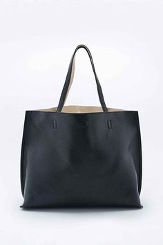 7735dbaf18cb3 Reversible Vegan Leather Oversized Tote Bag in Black and Ivory - Urban  Outfitters