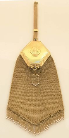 Stunning 14k gold purse / compact or as was called, a reticule. Impeccable workmanship, this purse was made circa 1900's. Two sapphire caboc...