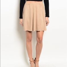 Gorgeous faux suede a line skirt! 1 LEFT! Beautiful flattering cut in a pretty neutral color to match all your boho tops- super cute with boots! Skirts