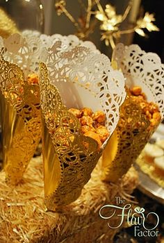 Pretty cones out of foil doilies - serve caramel popcorn, etc. in them
