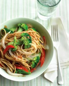 Martha Stewart - Lighter Sesame Noodles: Whole-wheat spaghetti complements the zesty sauce while adding fiber. A little less peanut butter plus a lot more vegetables make this a no-guilt meal. Recettes Martha Stewart, Martha Stewart Recipes, Vegetarian Recipes, Cooking Recipes, Healthy Recipes, Fast Recipes, Veggie Recipes, Veggie Meals, Cooking Food