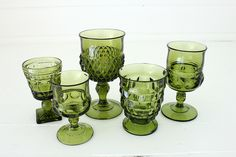 I've been working on collecting this green vintage glass for a while now. Have a few serving pieces, but nothing like these awesome glasses...