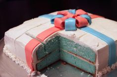 Gender reveal cake that looks like a gift on the outside.