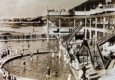 Capetonians cool off in the inviting waters at the pool in Sea Point while onlookers enjoy the shade of the Pavilion in this early photo. Note the low-rise skyline of the buildings in the background. Old Pictures, Old Photos, City By The Sea, Cape Town South Africa, Most Beautiful Cities, African History, Historical Photos, Surfing, Scenery