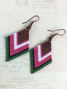 ***HANDMADE*** Miyuki Bead Brick Stitch Earrings I have chosen for this earrings brown, green, white, pink and black color miyuki sead beads made with brick stitch technique . Elegant Boho earrings for day or night. Measurements: 4,5 cm drop * Would you LOVE to own this and need a bigger