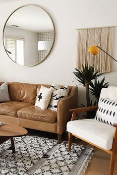 Apartment decorating is a fun challenge. Whether you're moving into your first studio apartment, updating the look of a small living room, or looking to give Brown Couch Living Room, Narrow Living Room, Small Apartment Living, Living Room Goals, Boho Living Room, Small Apartment Decorating, Living Room With Fireplace, Small Living Rooms, Living Room Designs