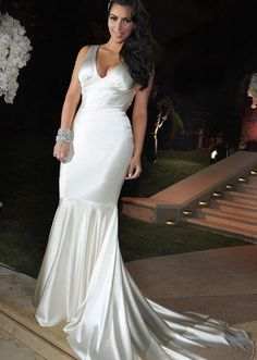 Kim Kardashian tied the knot with New Jersey Nets player Kris Humphries on August 20th, 2011. For her third and final gown, she changed into a slinky Vera Wang V-neck silk charmeuse gown that evoked Old Hollywood glamour. Vera Wang gowns are sold at The Bridal Salon at Saks Jandel.