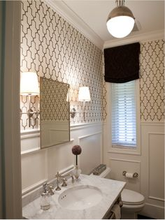 sophisticated black and white powder room with wallpaper