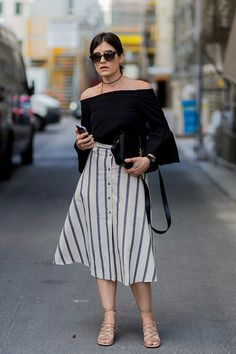 Off the shoulder top and vertical stripe skirt. 7 Summer Outfits That Make You Look 10 Pounds Lighter  #purewow #summer #style #outfit ideas #fashion #verticalstripes #offtheshoulder