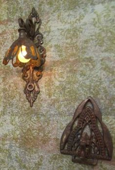 how to: wall sconce Look like vintage clip earring parts...will try this! (RM)