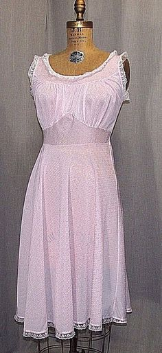 THIS NIGHTIE IS MADE OF PALE PINK 81% NYLON/ 19% ACETATE, IT HAS A DARKER PINK PATTERN. THE GOWN HAS A GATHERED BUST, AND FLAT SKIRT, IT HAS AN ASYMMETRICAL SKIRT SLIGHTLY LONGER ON ONE SIDE, THERE IS LACE AROUND NECKLINE ,SLEEVE HOLES AND HEMLINE. | eBay!