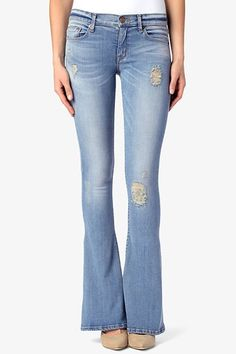 """The Angel Flare is fitted through the hips and thighs then breaks inches below the knee into a flare silhouette. It's a five pocket, regular rise fit with a 35.5"""" inseam."""