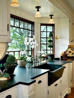 black framed window black granite counter