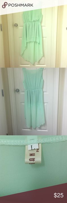 Teal high-low dress Teal high low dress. It has never been worn. NWOT! I have a 36DD bust and it fits me Dresses High Low