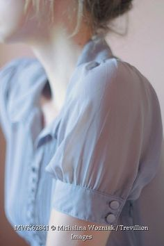 Trevillion Images - woman-wearing-pastel-blouse-close-up