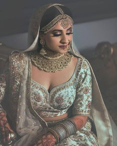 While selecting your desired bridal lehenga, don't forget to pick a stylish blouse design that will compliment your whole look. Bridal Portrait Poses, Bridal Poses, Indian Bridal Outfits, Indian Bridal Makeup, Indian Bridal Jewelry, Wedding Jewelry For Bride, Bridal Beauty, Blouse Lehenga, Lehenga Choli