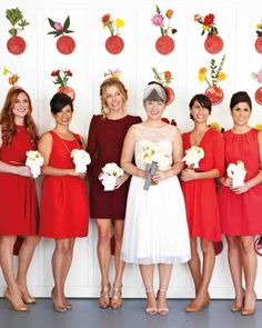 "30 Reasons to Love the Mismatched Bridesmaids Look | Martha Stewart Weddings - The only requirement this bride had for her attendants was to wear a ""knee-length red dress."" The style was up to the girls."
