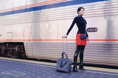 Black patent leather thigh boots outfit at the bus depot.