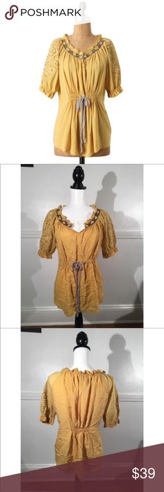 """Sains Sz XS/S Anthro Lucerne Peasant Yellow Blouse 🔸Sains Sz XS/S Anthro Lucerne Peasant Blouse EUC🔸Size XS🔸Anthropologie🔸Yellow/golden color🔸Eyelet sort sleeves🔸Beautiful beaded and embroided neckline🔸V neck🔸Stretchy peasant style blouse🔸Faux front tie, back elastic band for additional stretch🔸Elastic sleeve bands🔸Lose lightweight material🔸100% Viscose🔸Bust 32-34 (possibly 36""""- has stretch)🔸Pleated bust🔸EUC pre owned, great condition! I will steam and un-wrinkle the top…"""