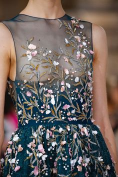 Flowers dominated Georges Hobeika's Fall/Winter 2016-2017 haute couture collection and shantung silk, crystal and pearl lotuses bloomed on metallic lace, organza embroidered with silk, gazar and crepe. It was like spring in winter! {Facebook and Instagram: The Wedding Scoop}