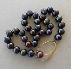 Love the clasp: Peacock Chinese freshwater pearl necklace with oval 9ct yellow gold clasp by Lilian Busch