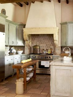 French country kitchen, stone / stucco range hood
