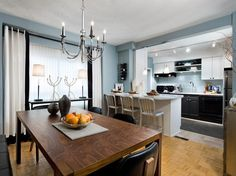 Serenely Blue  The backsplash is the perfect area to inject personality into your kitchen. Glass tiles that complement the grey-blue walls create a clean, contemporary backdrop between the contrasting black and white cabinets.
