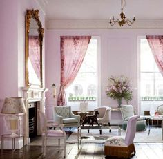 Color Theory: Painting the Walls With Lavender: The palest of lavender on the wall coordinates with the pink and lavender textiles in this sophisticated bedroom.   Source:  Flickr User coco+kelley  : This living room is feminine and dramatic, thanks to the deep pink curtains and pale lavender walls. The velvet tufted furniture doesn't hurt, either.  Source