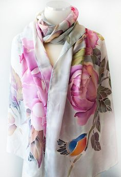 Peonies are the most sensual flowers with their delicious scent and soft colors. In feng shui, peonies are used for improving love & romance. They also represent beauty and prosperity. Of course, nothing is better than a bucket of gorgeous flowers in your room, but on this shawl they will