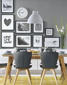 Need modern dining room decorating ideas? Take a look at this dining room with black and white pictures for decorating inspiration. Find more modern dining room design ideas at theroomedit.com