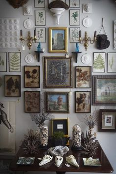 Reminiscent of Victorian royal palace walls cluttered with family portraits, this modern take with cameos and silhouettes is a fascinating way to display your family history.