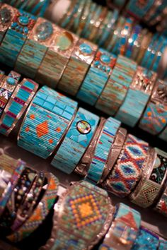 Southwestern style bracelets - love the mix of different designs and colors.