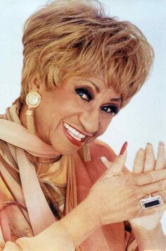 """One of the most popular salsa artists of the 20th century, Celia Cruz earned twenty-three gold albums and was a recipient of the National Medal of Arts. She was renowned internationally as the """"Queen of Salsa"""", """"La Guarachera de Cuba"""", as well as The Queen of Latin Music. She spent much of her career working in the United States and several Latin American countries."""