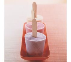 Yogurt Pops  Exactly what I was looking for! :)   A healthier altnernative to ice cream, and oh so delicious! :)   No pop holders...no biggie! Just put the mix in a dixie cup with sticks, cover and freeze! Woot Woot! :)