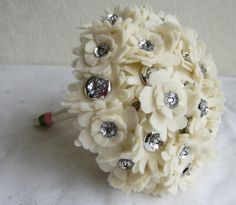 Again, not flowers but....Cream felt flower button wedding bouquet