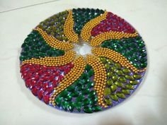 This is a useless CD, which i tried to decorate with ball chain and kundans Diy Crafts For Home Decor, Cd Crafts, Diy Art Projects, Cardboard Crafts, Craft Stick Crafts, Hobbies And Crafts, Arts And Crafts, Diwali Diy, Diwali Craft