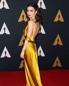 """Lily Collins """"Privileged to have attended this year's #GovernorsAwards gilded in @AmandaWakely..."""""""