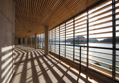 The elegant 'Rowing center Bled / Sport pavilion as a spectator stand' by MULTIPLAN ARHITEKTI has entered the #waterfrontaward | #Bled #Slovenia © Bor Dobrin