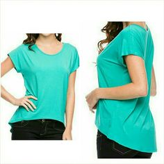 """Mint green short sleeve high low top Small NWT Super soft mint green high low top. Size small. Fits ladies 5/6.  Smooth 95% rayon 5% spandex. Not sheer or see through.24"""" long in the front, 26"""" long in the back. Brand new with tag. Jill Marie Boutique Tops Tees - Short Sleeve"""
