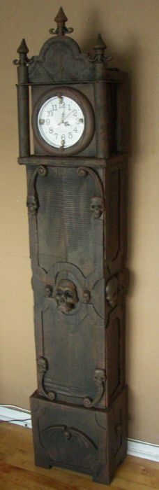 This is an Awesome Idea- Make your own grandfather clock out of Cardboard & dollar store Items :)      http://www.halloweenforum.com/halloween-props/120838-grandfather-clock-cardboard-dollar-store-items.html