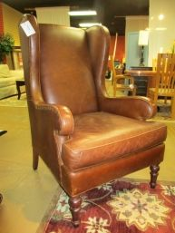 """Price: $299.99  Item #: 33509 Transitional-style leather wingback chair from Mitchell Gold, 30""""wide x 31""""deep x 46""""high. At the time of posting we have two in the store."""