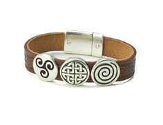 "The magnetic closure will keep the bracelet snapped safely and securely! Available in two lengths, 7"" or 7 ½"", this bracelet will surely fit most anyone! The Celtic charm bracelet is beautifully crafted from high quality leather. The genuine Irish leather is vegetable tanned, a process that uses natural ingredients such as the bark of chestnut trees creating a long lasting leather bracelet! The silver charms are crafted from metal. This leather charm bracelet is made in Co. Cork, Ireland"