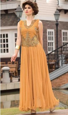 Look charming dressed in this beige color net embroidered gown. The beautiful crystals, resham and stones work a vital attribute of this gown. #LatestDarkBeigeFlaredGown