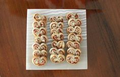 Food Lust People Love: Ham and Mustard Spirals. Flavorful ham and sharp whole grained mustard bake up crispy in puff pastry to create these lovely ham and mustard spirals. They are a quick and easy appetizer for your red carpet party.