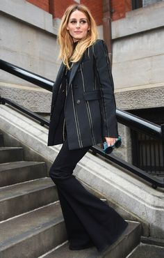 Olivia Palermo in a black striped blazer and flare pants