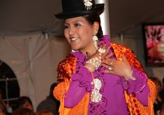 This fine orange shawl is an essential accessory for the Cholita look