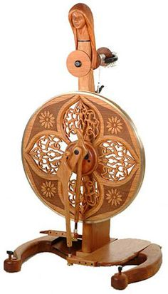 "Amazing hand carved spinning wheels from Golding Fiber Tools.  This one is ""Habetrot"" (Celtic Spinning Goddess) made of cherry wood with ebony accents."