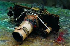 Prague's Miroslav Tichý 's camera, made from shoe-box cardboard, tin cans, cigarette boxes, toilet paper rolls, elastic string and lenses were Plexiglas rounds polished with ash and toothpaste.