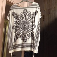 Aztec print tunic Good condition black and white Aztec tunic. Comes with braided belt. Can be tied in front, back or worn without it. Slight fraying around edges as seen in pics. Cleo Tops Tunics